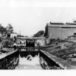1910's view of Lock No. 1 taken by W.R. Hicks. Next to the lock is one of the many wait shanties that allowed the boat crew to rest during the locking through process. Credit: National Park Service