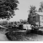 Early 20th century photograph of Lock No. 3. The building in the background was leased at the time of this picture as a veterinary hospital that catered to the mules used along the towpath. Credit: National Park Service