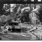 The Canal Clipper I was the first interpretive boat tour given on the C & O Canal. This 1962 photograph was taken in Georgetown near Lock 3. Credit: National Park Service