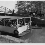 Photograph of an early canal barge interpretive tour given Oct. 24, 1954 at the mule crossover bridge in Georgetown. Credit: National Park Service