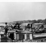 Canal boats loaded with coal wait in the Potomac River just outside of the tide lock to be tugged to the coal ports of Virginia. W. R. Hicks Photograph Collection Credit: National Park Service