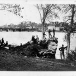 During the Civil War, the Union Army used the Alexandria Aqueduct as well as the Chain Bridge to secure the crossings from Virginia to Washington from Confederate forces. This photograph shows Union troops stationed on what is now Theodore Roosevelt Island with a view of the Alexandria Aqueduct in the background. Credit: Chesapeake & Ohio Canal National Historical Park