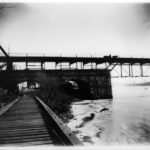 In the 1880s the aqueduct was no longer in use. The wooden aqueduct was removed and replaced with a steel truss structure that could carry heavier traffic to Virginia. Credit: Chesapeake & Ohio Canal National Historical Park