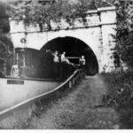 Boat leaving tunnel