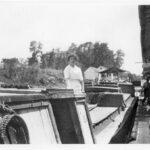 Woman on boat locking through
