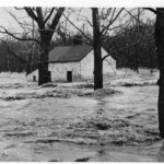 Lockhouse 6 Located just outside of Georgetown, Lockhouse 6 is seen here during the 1936 flood. After the flood the United States Government purchased the C&O Canal from the B&O Railroad. Credit: Unknown