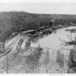 After the canal was purchased by the Federal Government, repairs were started to the area of Widewater. This 1940 photo shows some of the work done to the towpath during the time the Civilian Conservation Corps was repairing the canal. It shows the large waste weir (the series of piers under the towpath in the upper right quadrant) built in 1939. Credit: Chesapeake & Ohio Canal National Historical Park