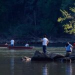 Fisherman bait their hooks and cast their hopes during the annual shad run. Credit: Roy Sewall