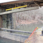 Boards are lowered one at a time. Credit: Chesapeake & Ohio Canal National Historical Park