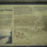 A wayside exhibit near the ruins helps explain the construction and role of the incline plane. Credit: Chesapeake & Ohio Canal National Historical Park