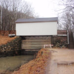 This photo shows the boards of the Stop Gate lowered. Credit: Chesapeake & Ohio Canal National Historical Park