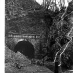 Photograph of the north portal. Rock slides have covered the towpath and the railing from the fence has been taken apart. Credit: National Park Service