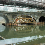 When the arches were completed,the wooden arch forms were removed leaving the arches free standing. This is the first time since the collapse in 1972 that the arches have stretched over Catoctin Creek. Credit: C&O Canal National Historical Park