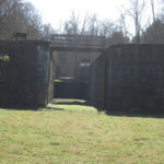Two of the four locks can be seen by standing in the canal prism. Looking upstream, visitors can see the only watch house on the canal in the upper right corner. Credit: C&O Canal National Historical Park
