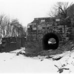 After the 1924 flood, the canal at Harpers Ferry was left dry. This photograph was taken after the National Park Service cleared the brush and trees that had taken hold in the lock and canal prism. Credit: National Park Service