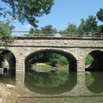 Today, visitors can once again appreciate the beauty of the newly rebuilt Catoctin Aqueduct. The Catoctin Aqueduct Restoration Fund began a grassroots effort to raise money for the restoration of the 'Crooked Aqueduct.' Credit: C&O Canal National Historical Park