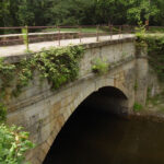 The Fifteenmile Creek Aqueduct, one of eleven, is a single-arch bridge crossing one of the Potomac's tributaries at Little Orleans, Maryland. Credit: C&O Canal National Historical Park
