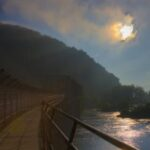 Early morning fog and the rising sun enhance the natural beauty of this confluence of two rivers in a valley. Credit: David P. McMasters