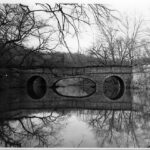The Catoctin Aqueduct, with it's elliptical center arch, was still mostly standing when this photograph was taken in 1971. The opposite berm wall had already collapsed and the center arch was in danger of collapse. In 1973 the aqueduct collapsed into the stream and the National Park Service would span the gap with a modern bridge. Credit: J. Rottier Collection, Chesapeake & Ohio Canal National Historical Park