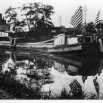 A patriotic loaded canal barge passing through, what was then, Berlin, Maryland c. 1910. Credit: Chesapeake & Ohio Canal National Historical Park