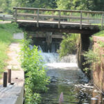 Lock 21 is still used today. Park staff will open and close the wickets on a daily basis to adjust the waterlevel downstream so that the mule-pulled canal boat can operate. Credit: C&O Canal National Historical Park
