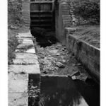 The river lock was used to allow boats traveling on the slackwater behind the dam to reenter the canal. It also acted as the water control structure for the canal downstream. Water would be let into the canal at this point to allow for the use of the locks and boat travel. Credit: F.R. Holland, Chesapeake & Ohio Canal National Historical Park