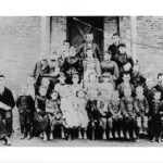 Children pose for their picture outside the one room school house at Four Locks. Credit: Chesapeake & Ohio Canal National Historical Park