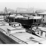 The terminus of the canal was not only the site of loading boats with their coal cargo but it was also the site of many of the boat building enterprises that catered to the canal boatmen. New boats and repairs to old boats took place at multiple boat yards similar to this one. Credit: Chesapeake & Ohio Canal National Historical Park