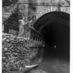 Photograph of the Paw Paw Tunnel downstream portal prior to the work done by the Mission 66 construction crew. Credit: National Park Service