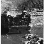 View of the debris pile and the remaining west wing wall of the Catoctin Aqueduct in 1973. Credit: K. Quinn Collection, Chesapeake & Ohio Canal National Historical Park