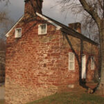 Even an overcast winter day cannot diminish the warm glow of the red sandstone exterior of the lockhouse. The stones used to build both the lockhouse and the aqueduct were quarried a short distance upstream. Credit: Doug Zveare