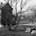 1970s view of Lockhouse 70. Notice the pile of stones from a nearby canal structure. Credit: Chesapeake & Ohio Canal National Historical Park