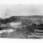 Canal boats line the canal waiting to bring their cargoes down stream to the markets of Williamsport and Georgetown. In the foreground are boats waiting to be loaded with coal. Credit: Chesapeake & Ohio Canal National Historical Park
