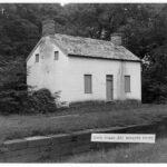 After the park was established Lockhouse 25 at Edwards Ferry was preserved by shuttering the windows to allow air circulation and security and the surrounding vegetation was cleared. Credit: W. Williams, Chesapeake & Ohio Canal National Historical Park