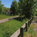 When biking and hiking along the Rail Trail west of Hancock, it is not uncommon to pass many old abandoned homes. Credit: Department of Natural Resources