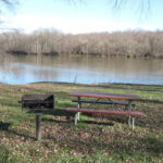 Several tables with grills provide visitors a place to have lunch or a snack. Tables are shaded and overlook the Potomac River. Credit: C&O Canal National Historical Park