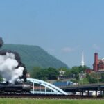 The Cumberland skyline with the Narrows in the background and Mt. Thunder approaching the Western Maryland Railway Station in the foreground. Credit: Chesapeake & Ohio Canal National Historical Park