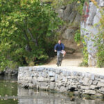 Conceptual View; once complete pedestrians and cyclists will travel a towpath reconstructed between the Potomac River and rock cliffs. Credit: C&O Canal National Historical Park