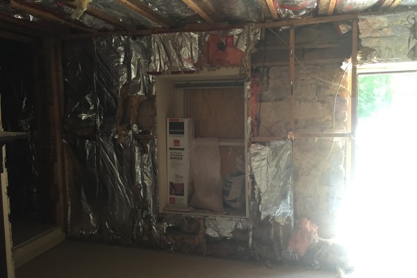 During demo: The 1890s addition with dry wall removed and modern-day insulation intact