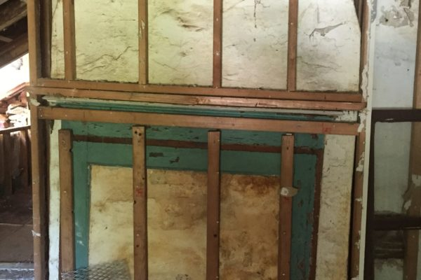 Post-Demo: A fireplace that had been covered in drywall