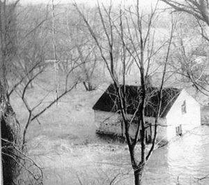 Lockhouse 8 surrounded by flood waters.