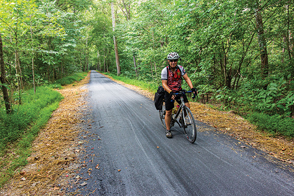 A biker enjoys the resurfaced towpath.